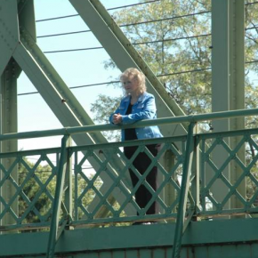 Actor Karolyn Grimes who played Zuzu stands on the bridge.